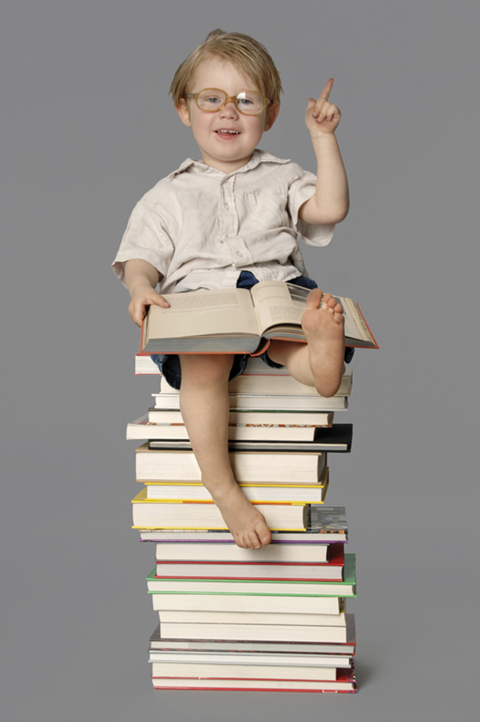 Boy on books.jpg